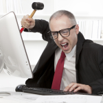 Nerd businessman angry with his computer